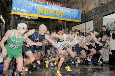 Men burst out from the starting line of the Empire State Building Run-Up. Photo Courtesy of New York Road Runners