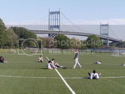 Athletes warm up on one of six new East River Fields that have opened on the southwest corner of Randalls Island.